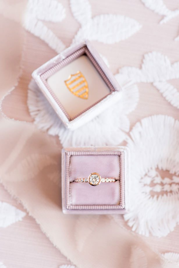Gold engagement ring on a blush velvet ring box - Lynne Reznick Photography