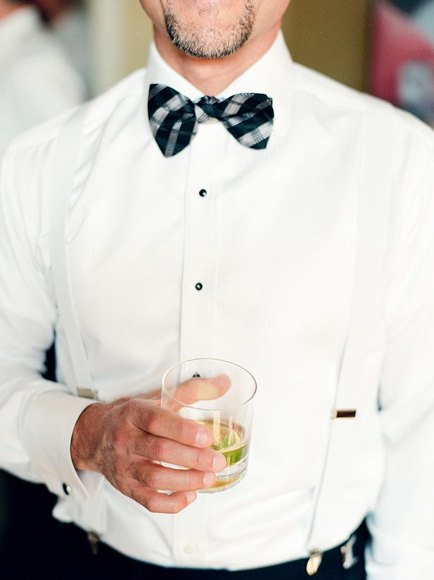 Groom black and white outfit with bow tie - Melissa Schollaert Photography