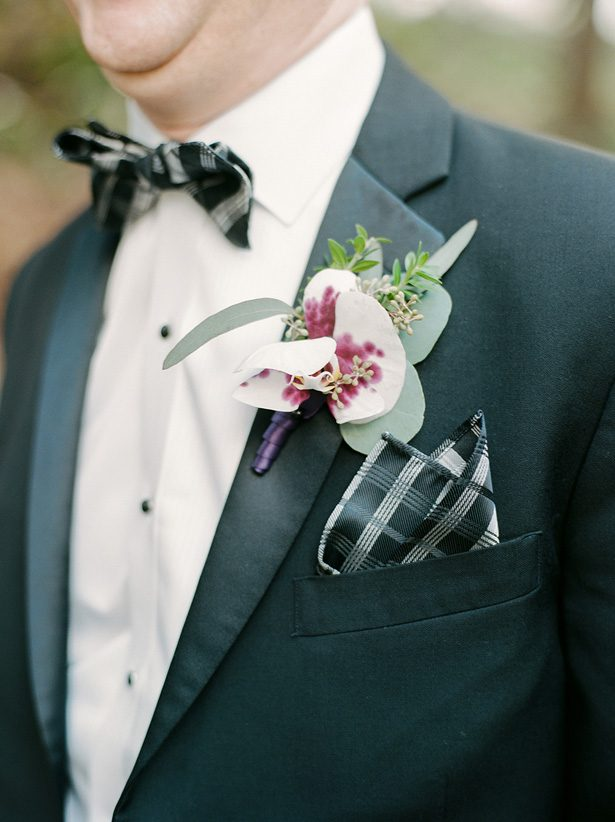Groom black and white suit with purple boutonniere - Melissa Schollaert Photography