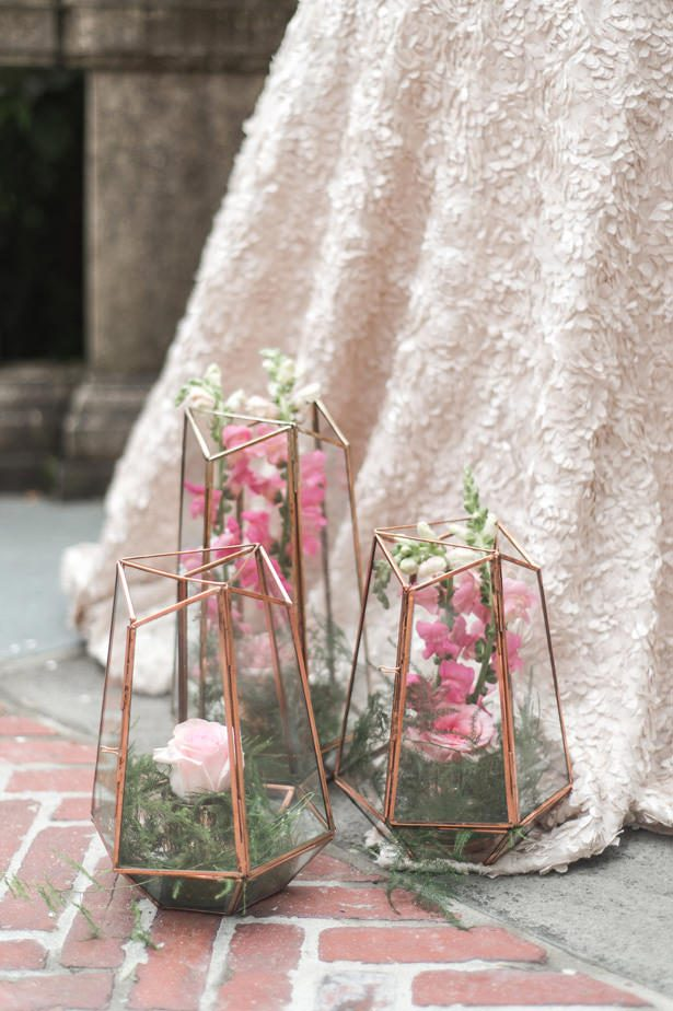 Pink wedding flowers on terrariums - Lynne Reznick Photography