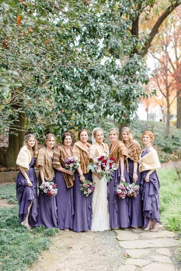 Purple long bridesmaid dresses with a fur cover up for a winter wedding - Melissa Schollaert Photography