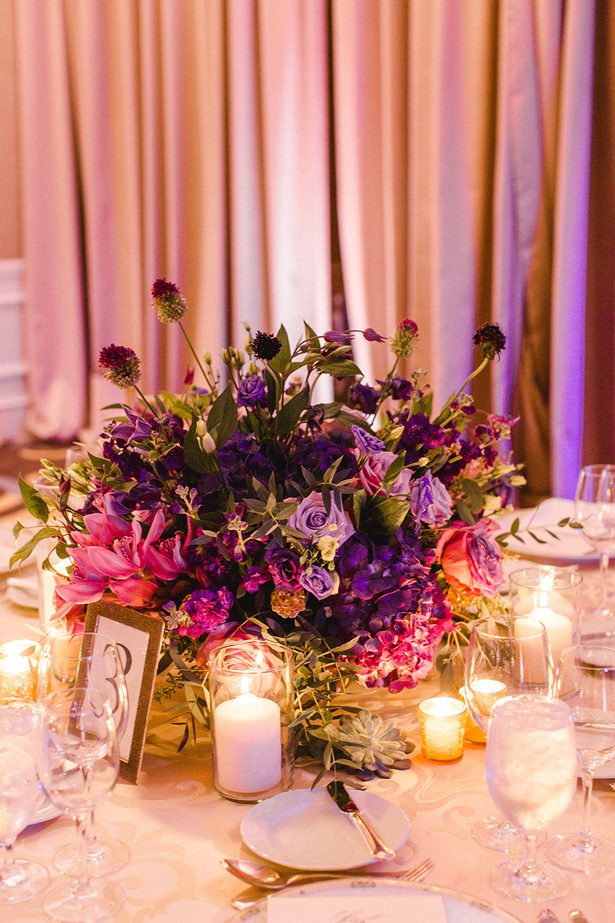 Purple low wedding centerpiece - Melissa Schollaert Photography