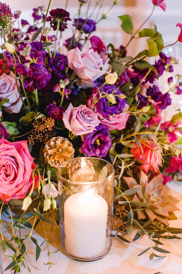 Purple low wedding centerpiece with candlelight - Melissa Schollaert Photography