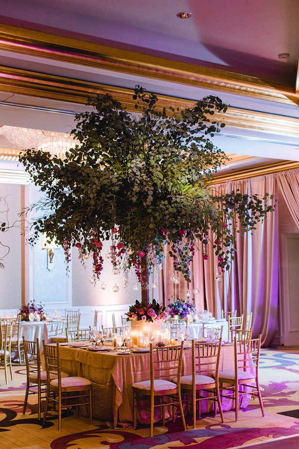 Tall tree wedding centerpiece with purple flowers - Melissa Schollaert Photography