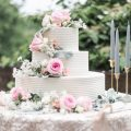 White buttercream wedding cake with fresh flowers and pink roses 2