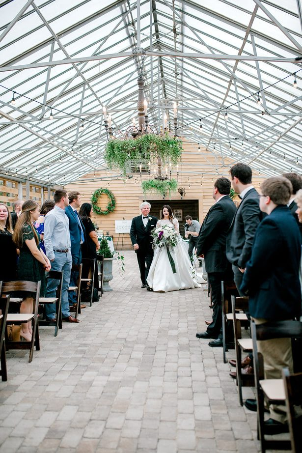 greenhouse wedding walk down the aisle - Honey + Bee Photography