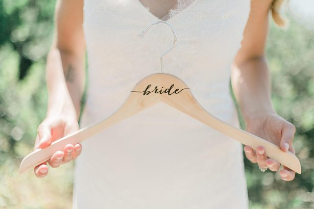 Bridal hanger - Unique Ways to Incorporate Calligraphy Into Your Wedding - Delovely Details