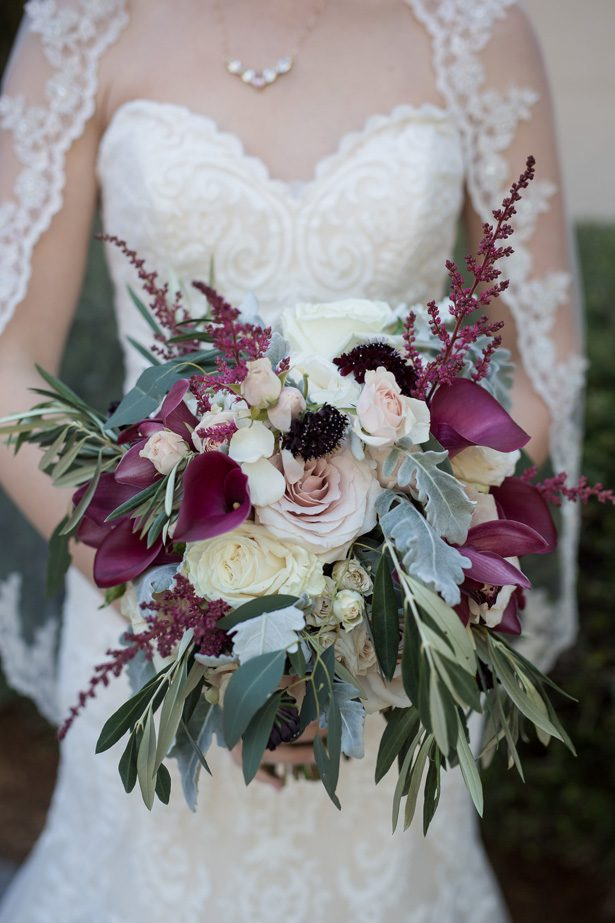 Dark purple and burgundy wild wedding bouquet with white roses and blush flowers- Cat Pennenga Photography