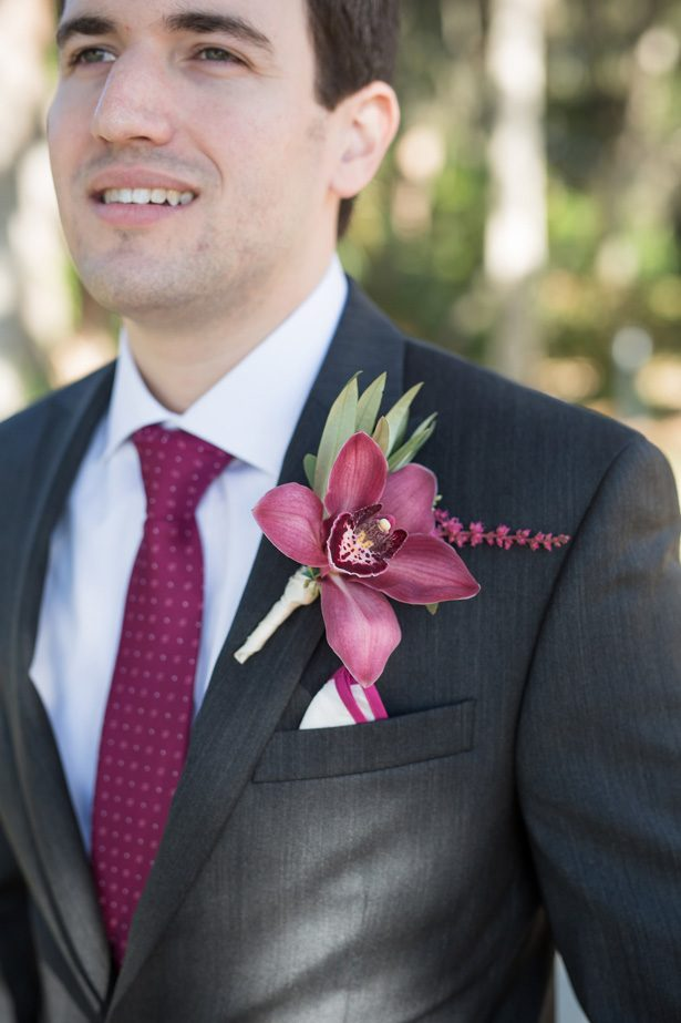 Groom wedding suit with burgundy tie and Burgundy wedding boutonniere- Cat Pennenga Photography