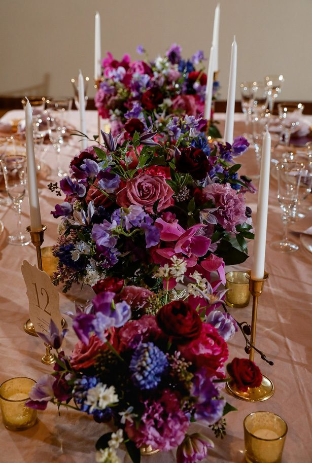 Long tablescape wedding centerpiece with purple flowers -Sherri Barber Photography