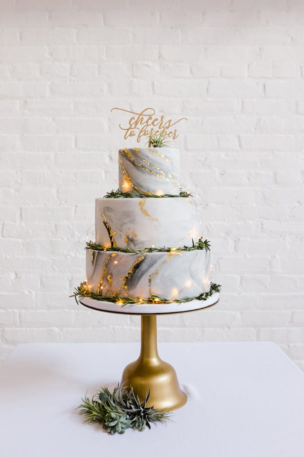 Marble wedding cake with gold and greenery with cake topper - Unique Ways to Incorporate Calligraphy Into Your Wedding - Love Me Do Photography