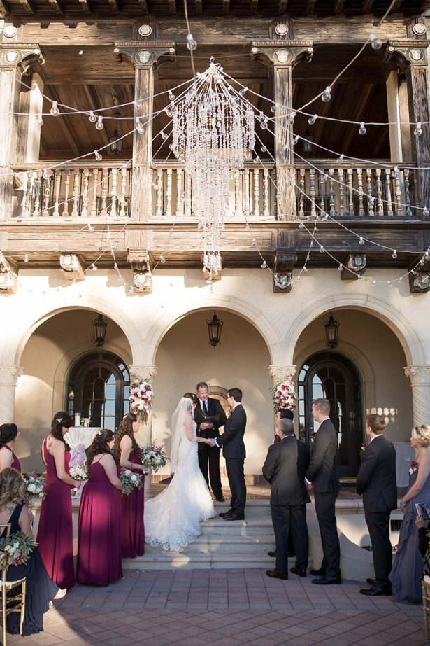 Outdoor burgundy wedding ceremony decor with crystal chandelier- Cat Pennenga Photography
