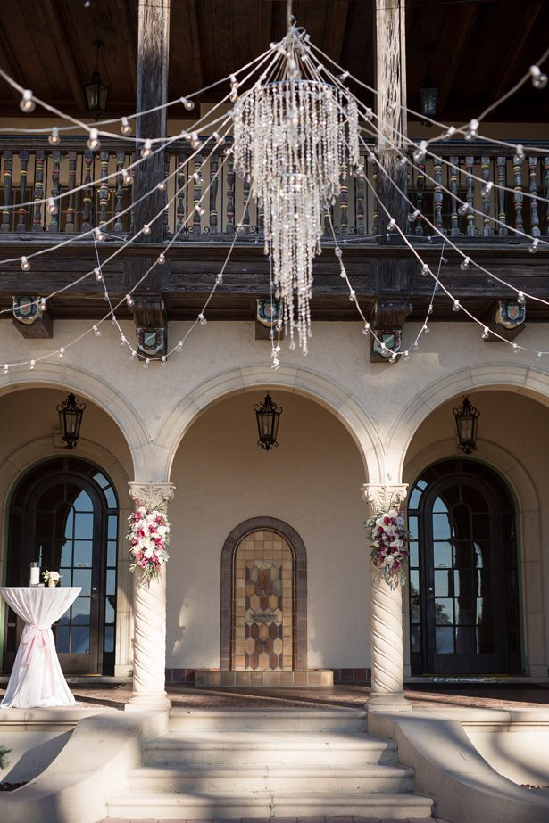 Outdoor wedding ceremony decor with crystal chandelier- Cat Pennenga Photography