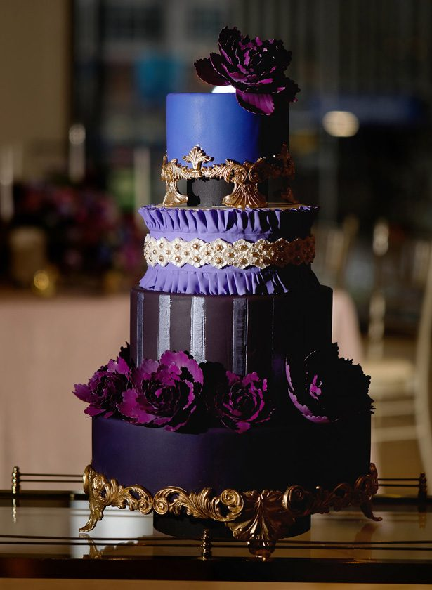 Purple Opulent Wedding cake with gold details and sugar flowers -Sherri Barber Photography