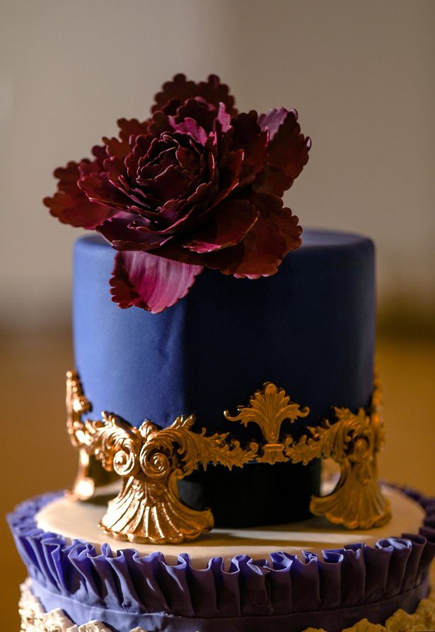Purple Opuletn Wedding cake with gold details and sugar flowers -Sherri Barber Photography