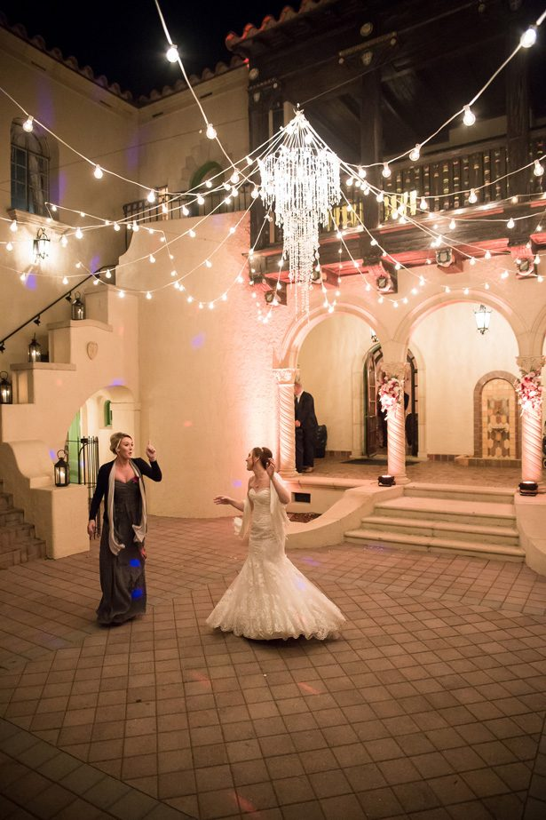 Wedding reception decor with crystal chandelier- Cat Pennenga Photography