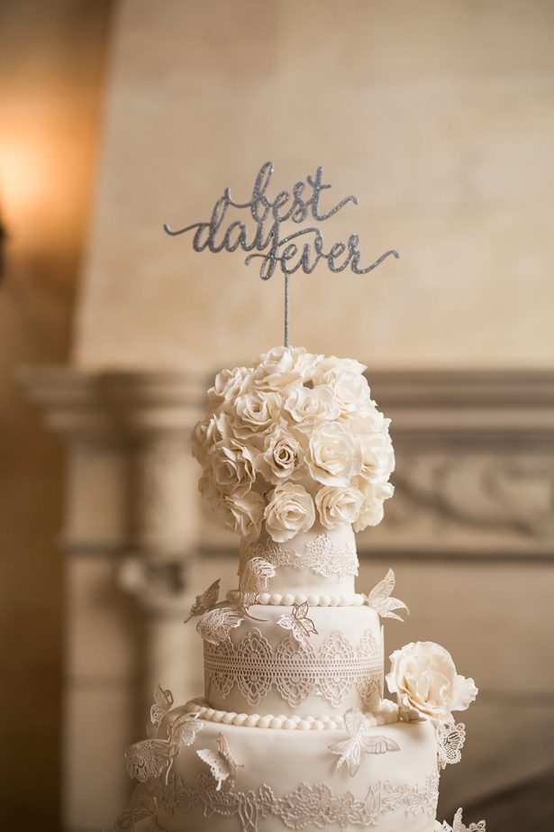 White luxury wedding cake with silver cake topper- Cat Pennenga Photography