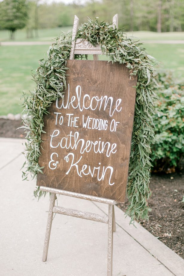 Wood wedding sign with greenery - Photography: Lauren Westra