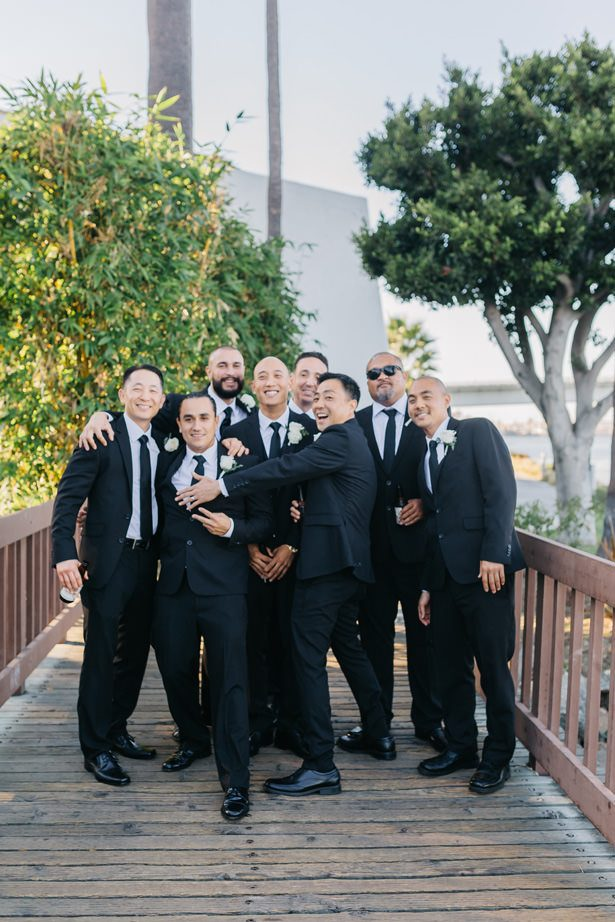 groomsmen matching black suit and tie - Nichanh Nicole Photos