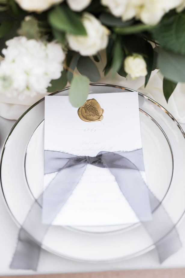 wedding menu with was seal and organza bow - Sarah Sunstrom Photography