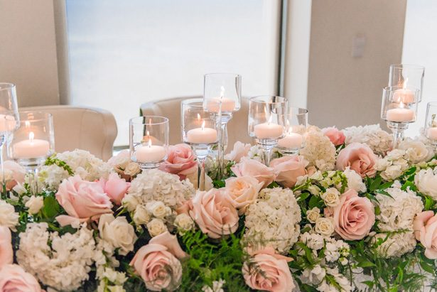 Garland wedding centerpiece with pink and white flowers -Classic Blush Wedding at The Houston Club - Nate Messarra Photography