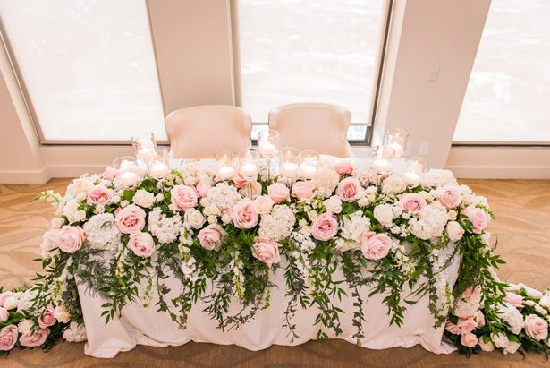 Garland wedding centerpiece with pink and white flowers for sweetheart table -Classic Blush Wedding at The Houston Club - Nate Messarra Photography