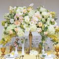 Tall wedding centerpiece for yellow tablescape - Photography: Szu Designs, Inc