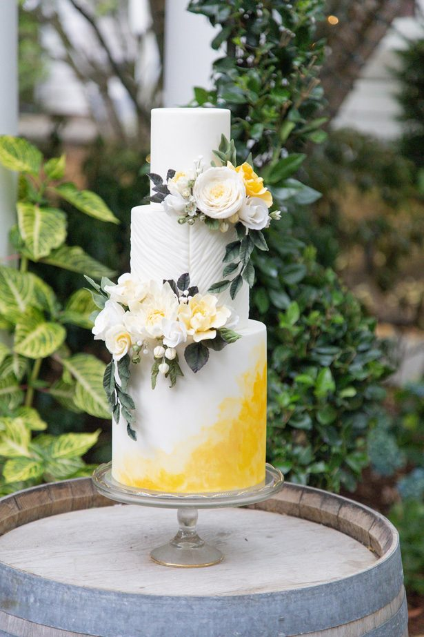 White and yellow wedding cake with fresh flowers - Photography: Szu Designs, Inc