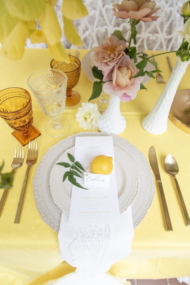 Yellow wedding place setting with lemon place card - Photography: Szu Designs, Inc