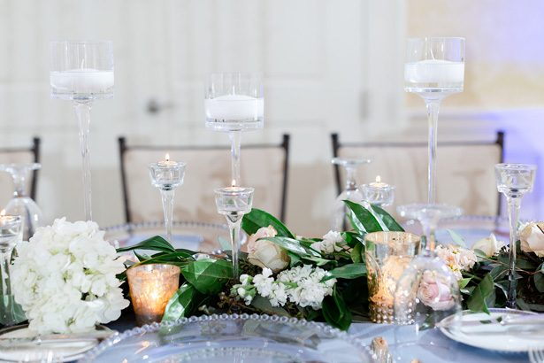 Wedding centerpiece table garland with candles - Luke & Ashley Photography