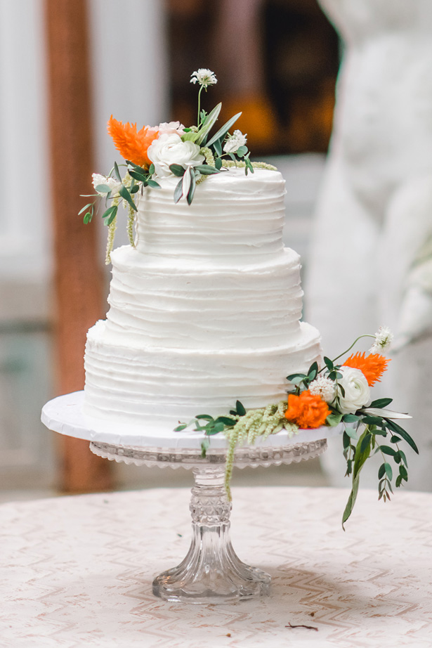 Classic Wedding Cake with orange accents - Krystal Healy Photography
