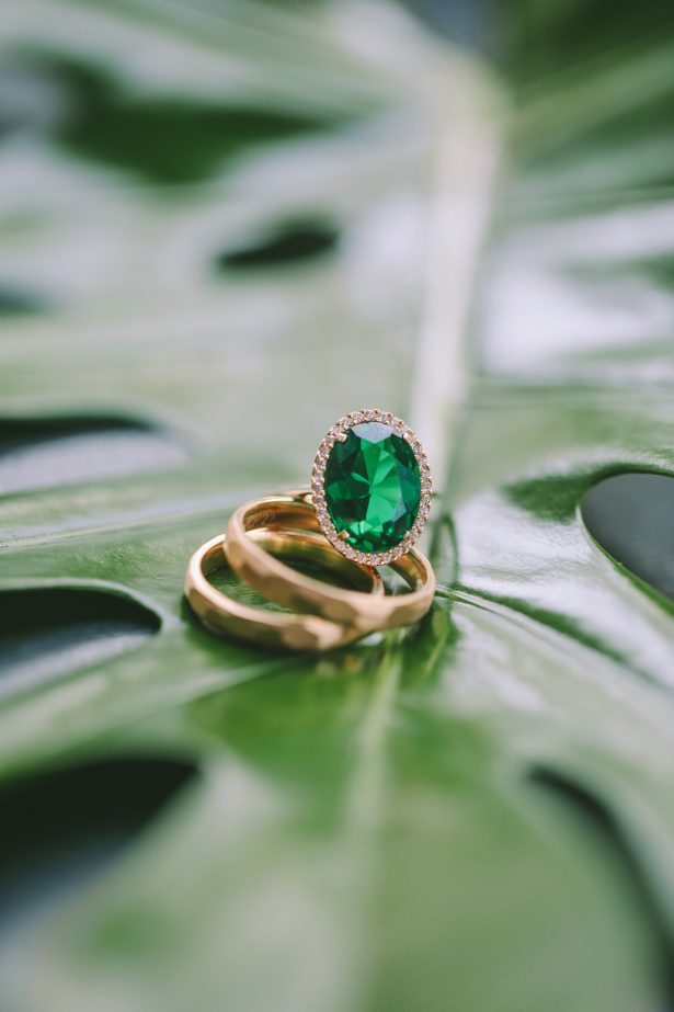 Emerald green and yellow gold engagement ring and wedding bands - George Pahountis Photographer