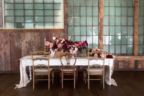 Long wedding tablescape with burgundy centerpieces - Photography: Szu Designs, Inc