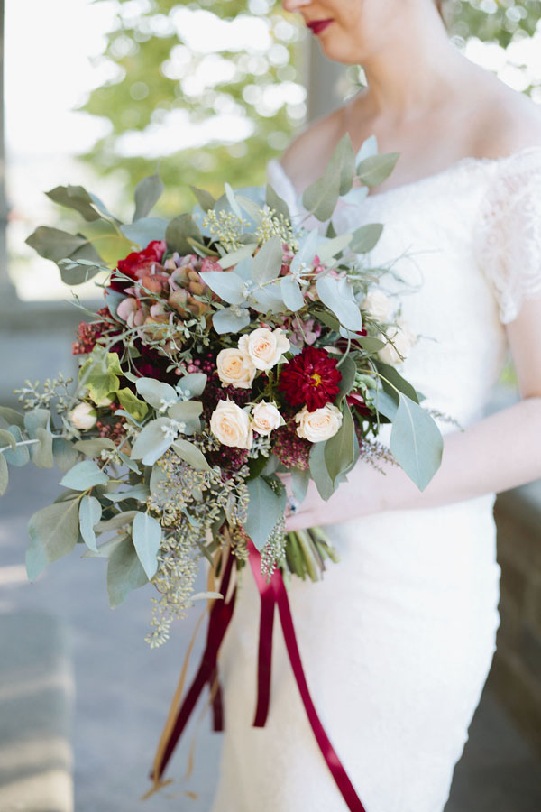 Fall wedding bouquet with burgundy flowers and greeneryFall wedding bouquet with burgundy flowers and greenery | Gold and Burgundy Wedding Details for an Elegant Elopement in Tuscany - Purewhite Photography