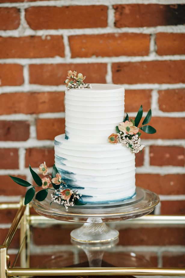 White buttercream wedding cake with blue ombre details and fresh flowers - Amanda Meg Photography