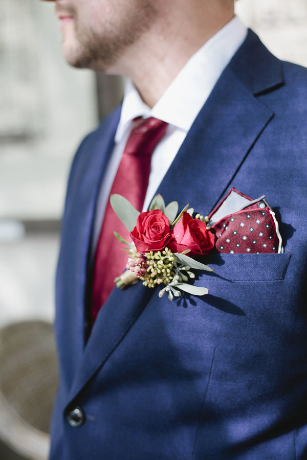 Blue groom's suit with burgundy boutonniere - Purewhite Photography