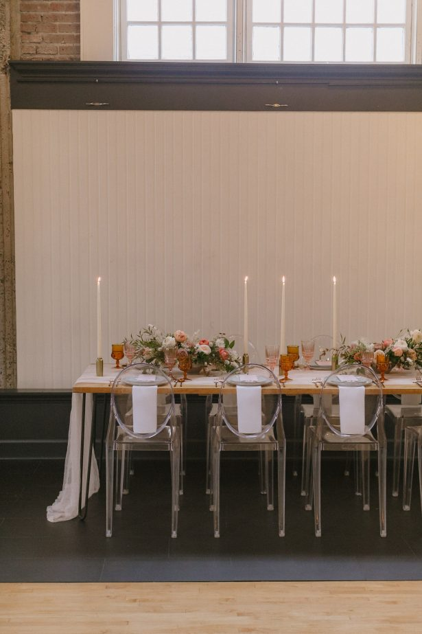 Long Wedding tablescape with modern acrylic chairs - Andrea Zajonc Photography