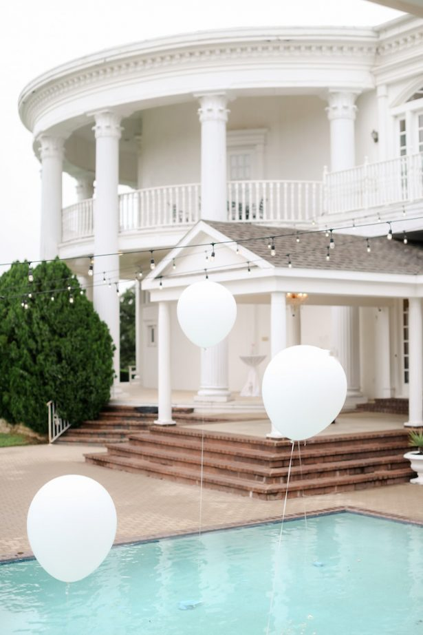 Pool Wedding decor with white balloons - Krystle Akin Photography