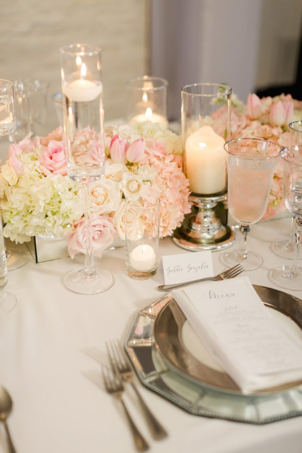 Low blush wedding centerpiece with candlelight and mirror place setting - Krystle Akin Photography