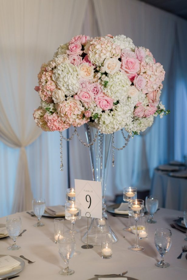 Tall wedding centerpiece with candlelight- Krystle Akin Photography