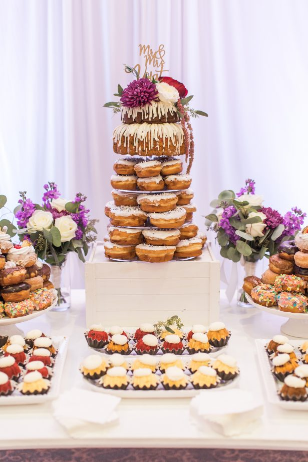 Unique bundt wedding cake and donut tower on dessert table - Photography: The Hendricks