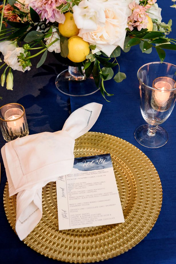 Gold and blue wedding place setting - Jenny DeMarco Photography