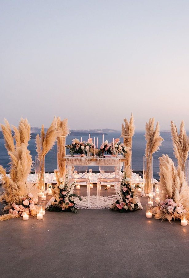 Pampas grass wedding decor with sweetheart table - Phosart Photography