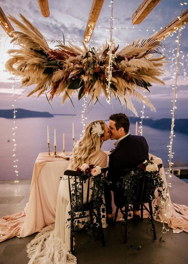 Pampas grass wedding decor with sweetheart table - Chris & Ruth Photography