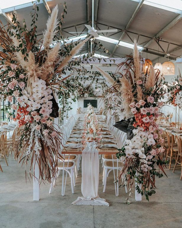 Pampas grass wedding reception decor - Photography: The Evoke Company