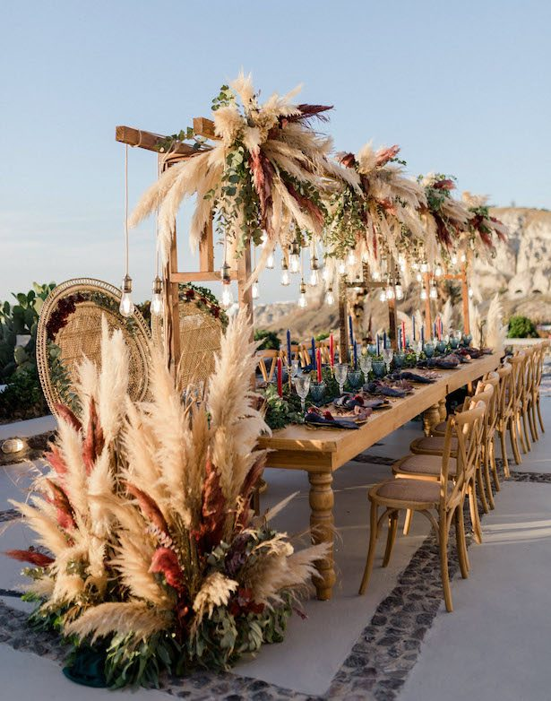 Pampas grass wedding reception decor - Photography: Anna Roussos