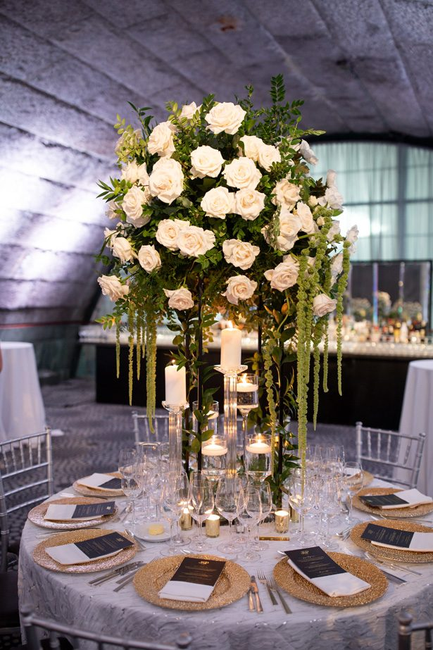 Round wedding tablescape with tall wedding centerpiece- Rafal Ostrowski Photography