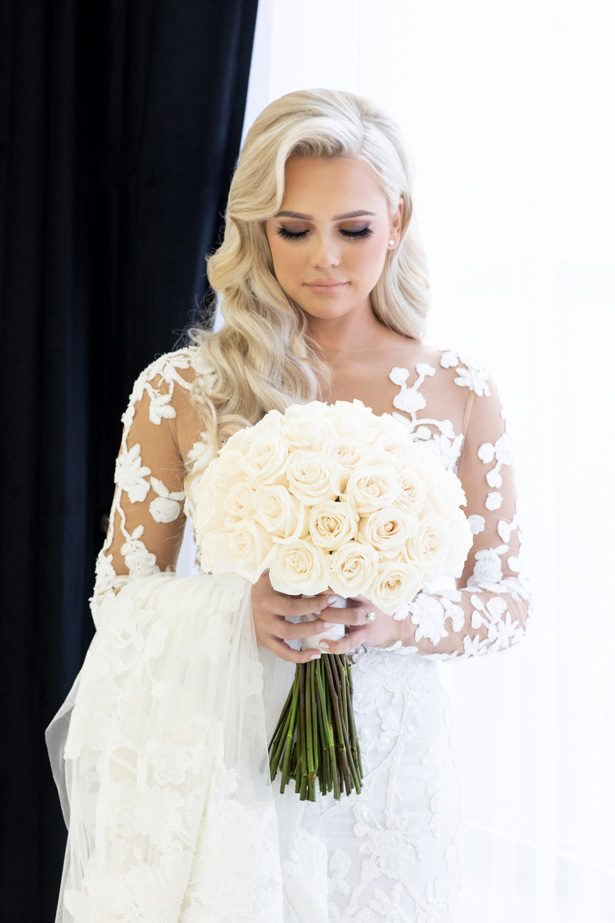Sophisticated bride with white rose wedding bouquet- Rafal Ostrowski Photography