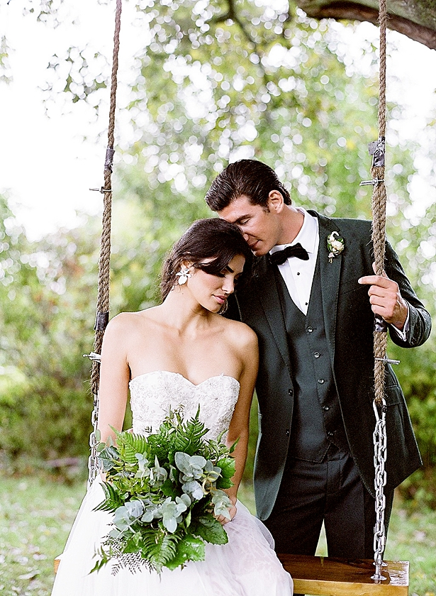 Bride and groom swing photo with all greenery wedding bouquet Barn Wedding - Twah Photography