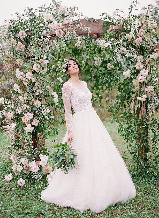 Bride in two piece lace wedding dress and romantic flower ceremony arbor Barn Wedding - Twah Photography